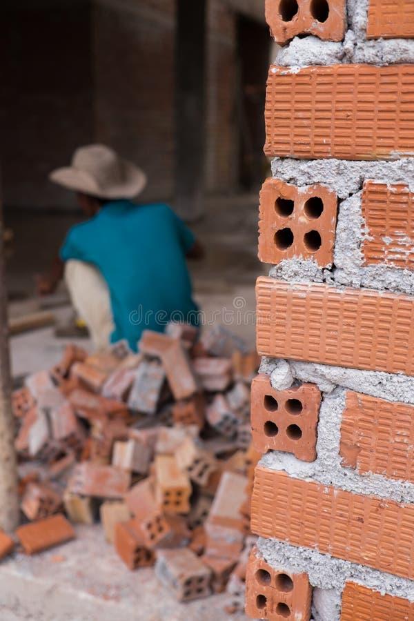 Construction mason worker bricklayer installing brick walls royalty free stock photo