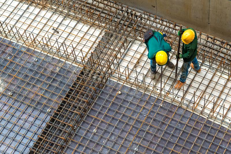 Construction mechanic repairing the structure of steel. Technicians are repairing the structure of steel stock photo