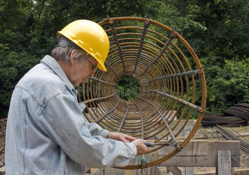Construction metal worker. Construction worker builds a steel support structure stock images