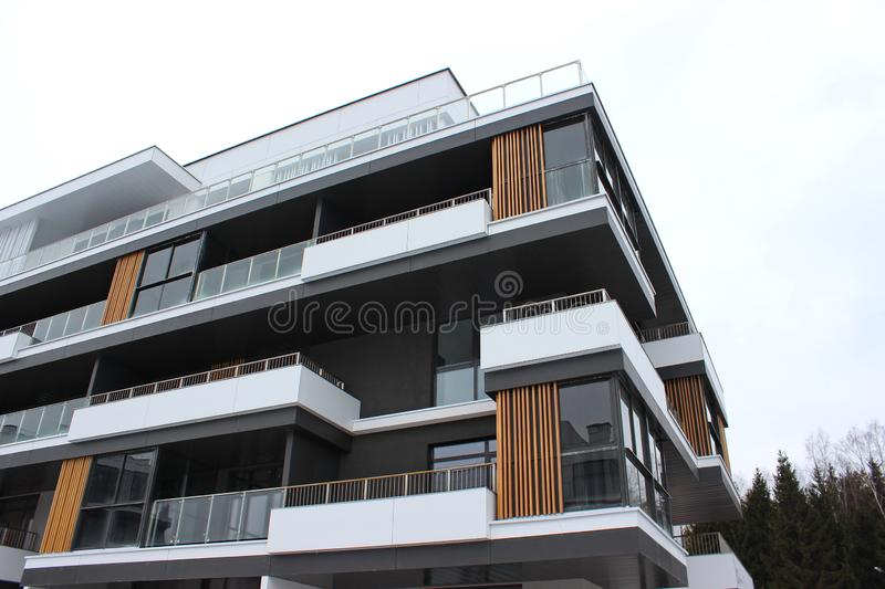 Construction of modern residential buildings. the combination of different materials and textures in the design. convenient layout. Construction of modern royalty free stock photo