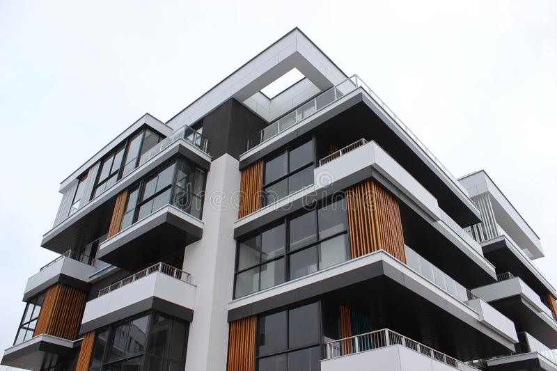 Construction of modern residential buildings. the combination of different materials and textures in the design. convenient layout. Construction of modern stock photography