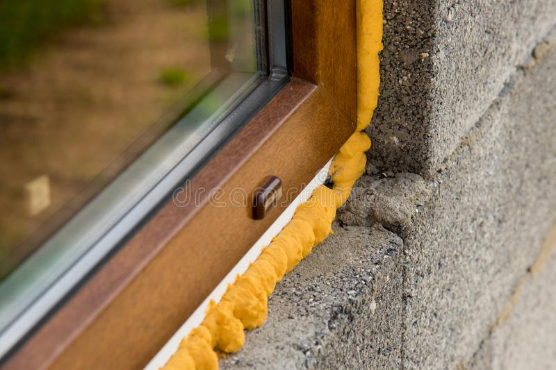 Construction mounting PU foam. DIY concept. Construction PU foam. The window is installed using a mounting foam. Installation foam stock image