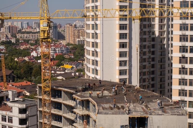 The construction of a multi-storey modern house on the seashore. Installation of floor reinforcement. Tower cranes. September 9,. 2019. Odessa. Ukraine, urban stock images
