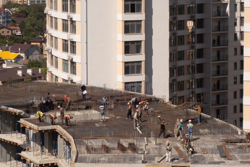 The construction of a multi-storey modern house on the seashore. Installation of floor reinforcement. Tower cranes. September 9,. 2019. Odessa. Ukraine, urban stock photo