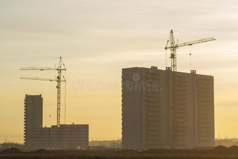 Construction of multi-storey residential buildings. construction cranes. The construction of a new area in the wasteland. ta royalty free stock photo