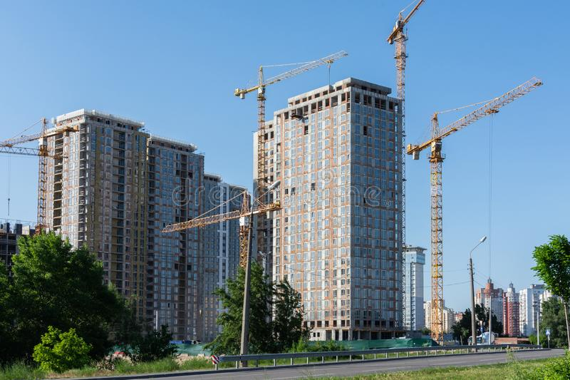 Construction of multi-storey residential buildings. Construction of residential buildings, new multi-storey houses in Kiev, the capital of Ukraine stock images