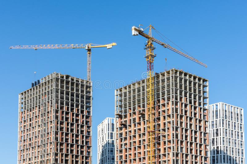 Construction of multi-storey residential buildings. Construction of residential buildings, new multi-storey houses in Kiev, the capital of Ukraine royalty free stock image