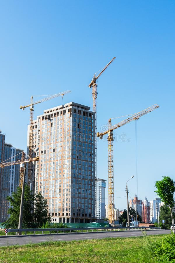 Construction of multi-storey residential buildings. Construction of residential buildings, new multi-storey houses in Kiev, the capital of Ukraine royalty free stock photography