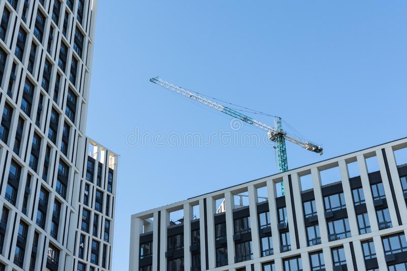 Construction of multi-storey residential buildings. Construction of residential buildings, new multi-storey houses in Kiev, the capital of Ukraine royalty free stock photo