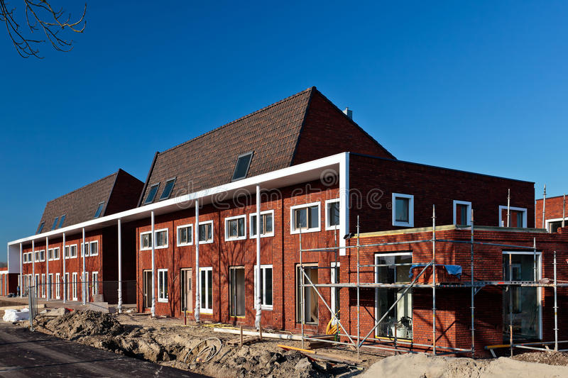 Download Construction Of Nearly Finished Family Houses Stock Photo - Image: 35414878
