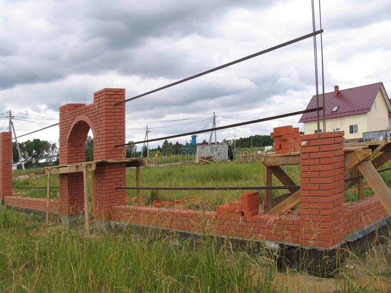 Construction of a New Brick Fence stock images