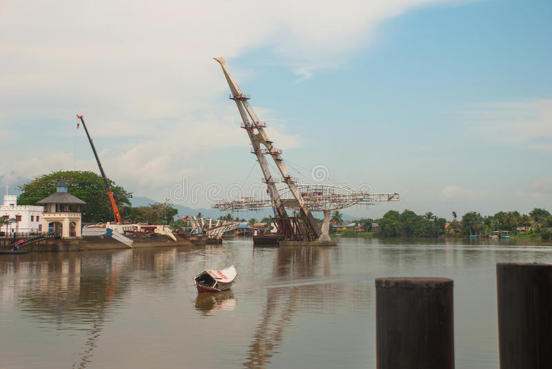 The construction of a new bridge across the river. Kuching, Sarawak. Malaysia. Borneo. The construction of a new bridge across the river in Kuching, Sarawak royalty free stock photography