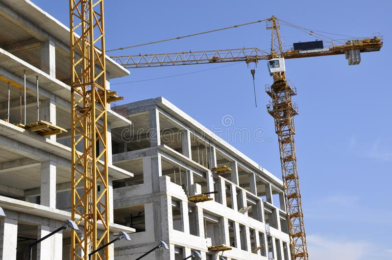 Construction of new building with attached crane stock photo