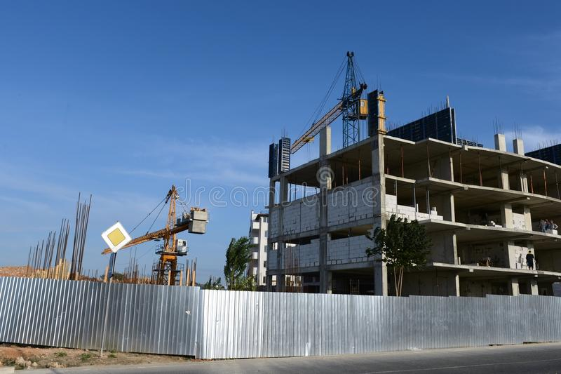 Construction of new homes in Sebastopol. SEVASTOPOL, RUSSIA - SEPTEMBER 18, 2014:Construction of new homes in Sebastopol. City in South-West of the Crimean stock photography