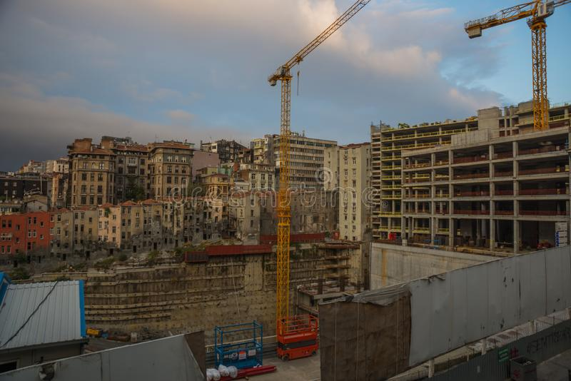 Construction of new houses. Cranes are demolished old buildings. Istanbul, Turkey.  royalty free stock photos