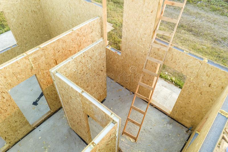 Construction of new and modern modular house. Walls made from composite wooden sip panels with styrofoam insulation inside. stock photo
