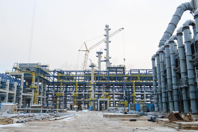 Construction of a new oil refinery, petrochemical plant with the help of large building cranes stock image