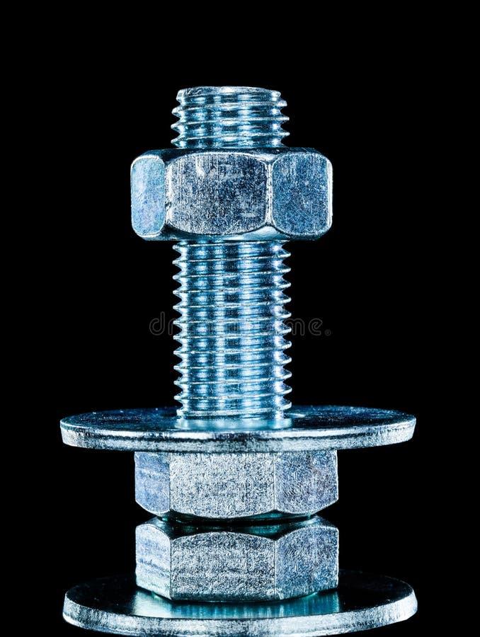 Construction nut screwbolt bolt washer on black background.  royalty free stock image