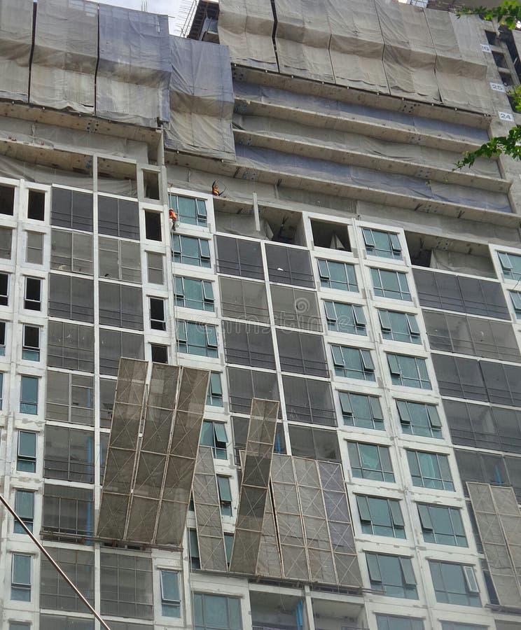 Construction of tall building stock photos