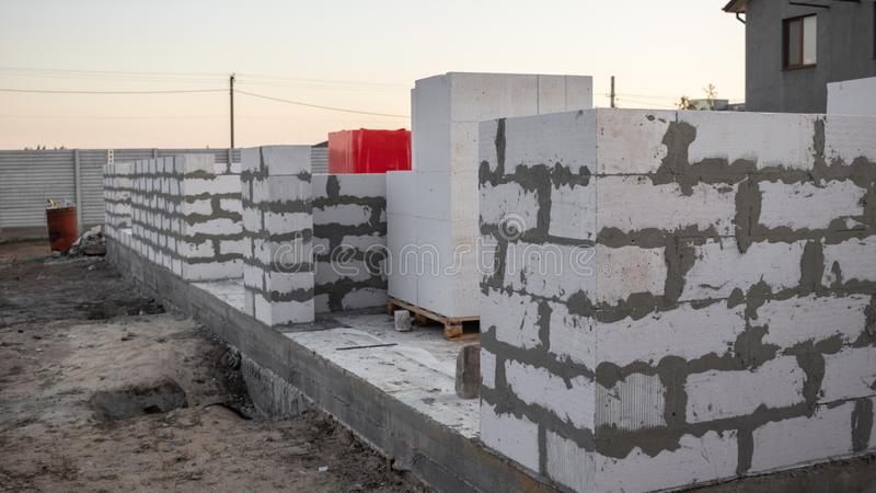 Construction of a one-story house with foundations of white aerated concrete. In Ukraine stock images