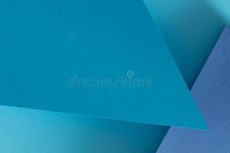 Construction paper collage background blue layers. Construction paper collage background. abstract blue layers. empty space concept royalty free stock photos