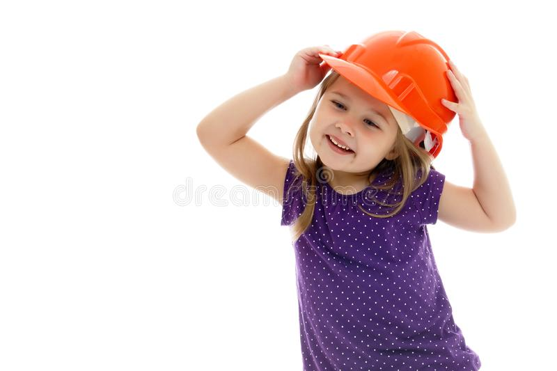 Little girl in the construction helmet. royalty free stock photo