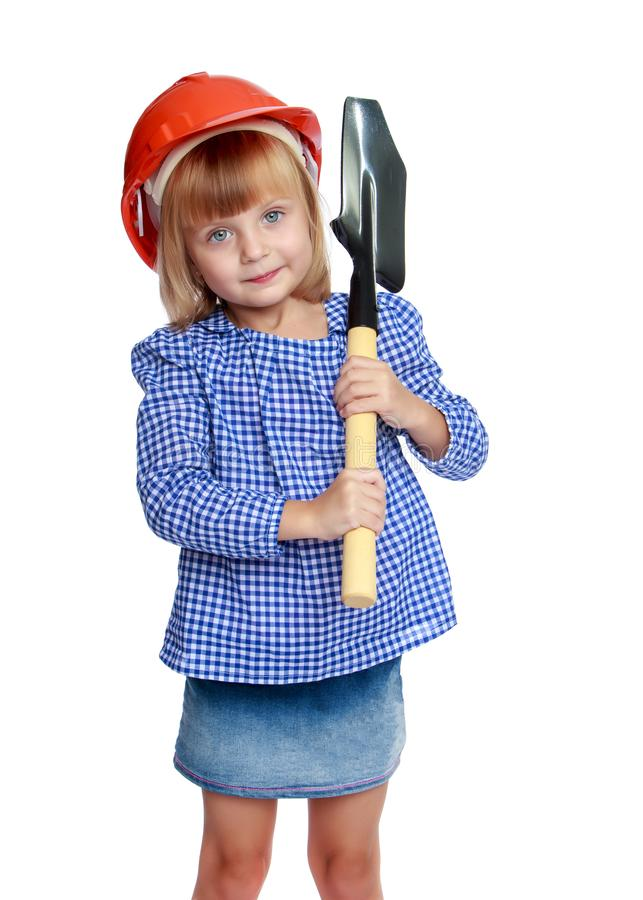 Little girl in the construction helmet. stock photos
