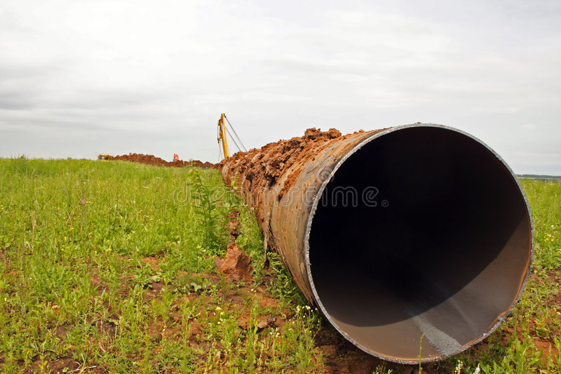 Construction of the pipeline. The tractor works on construction of the pipeline stock photos