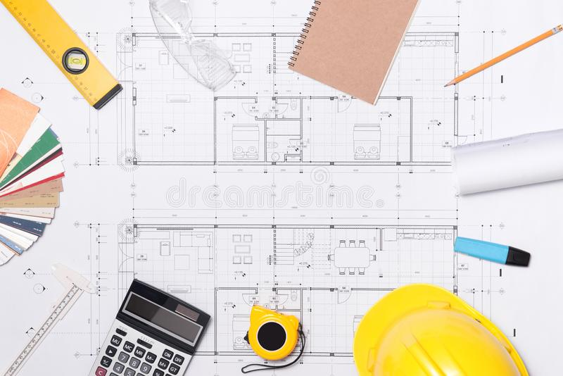 Construction plans with helmet and drawing tools on blueprints.  royalty free stock photos