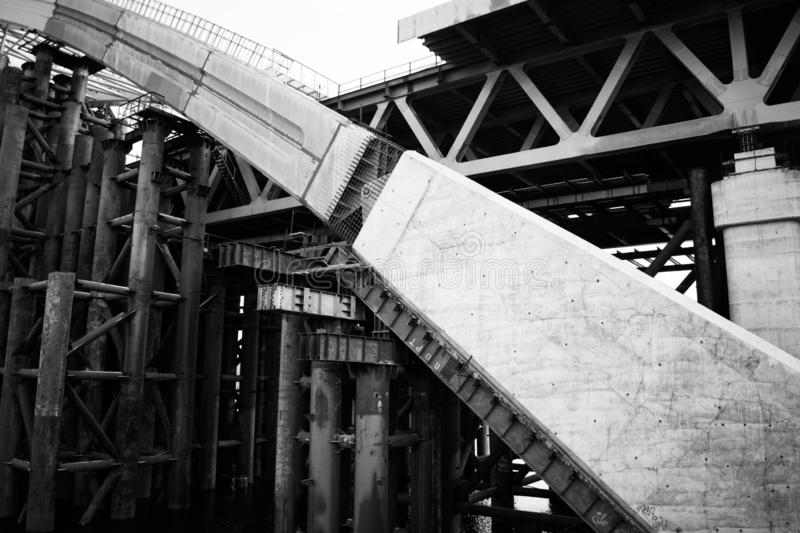 Construction of a powerful river industrial bridge royalty free stock photography