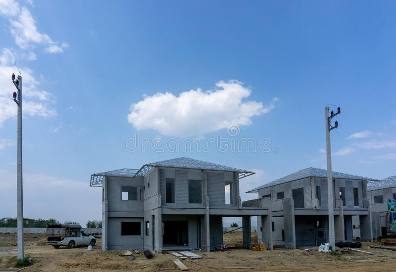 Construction progress in a real estate property project site, people are building the precast house on the brown land stock photography