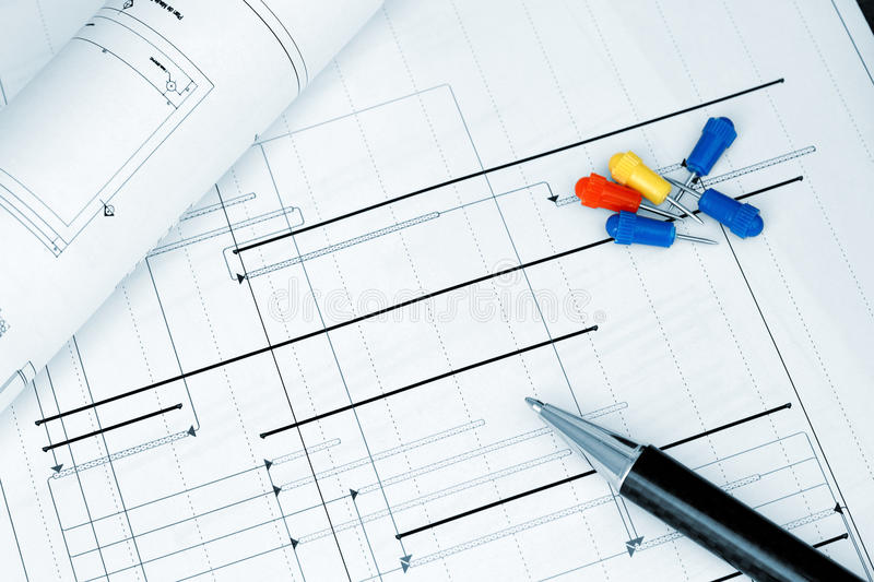 Construction project planning blueprint. Construction project planning tools and a pen - blueprint royalty free stock photos