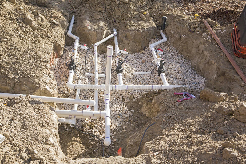 Construction pvc pipe sprinkler valves trench royalty free stock image