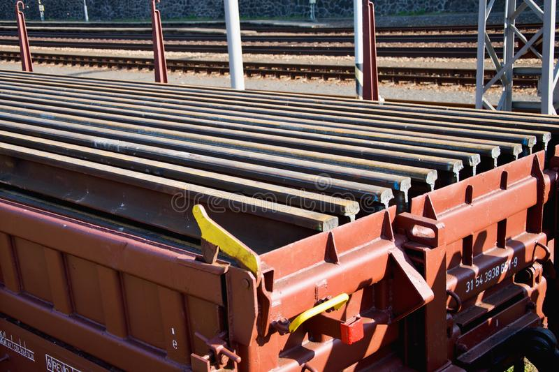Construction of railway tracks. Railway infrastructure. Railroad car loaded with rails. Rails on a wagon ready for track stock photos
