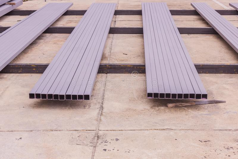 Construction: Rectangular steel tube with anti-rust paint preparing for fabrication of structural work stock image