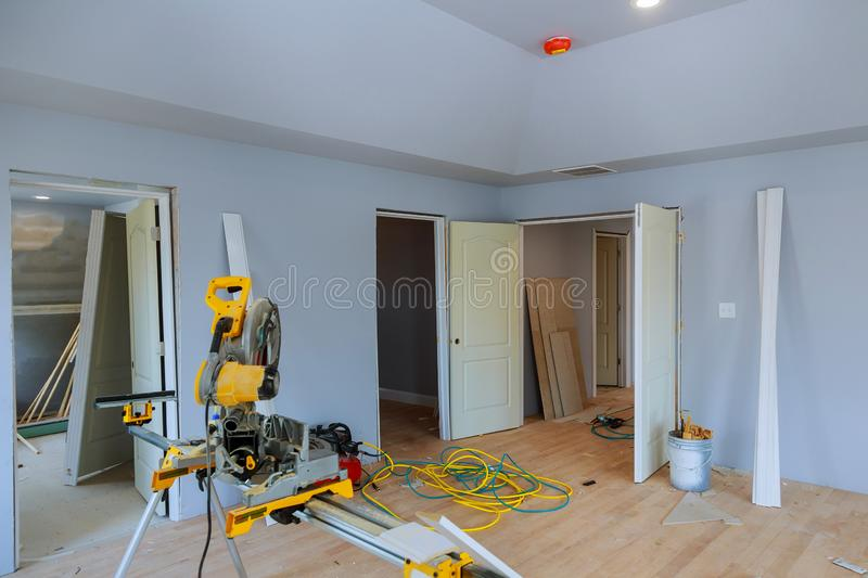 Construction remodeling home cutting wooden trim board on with circular saw. Cutting wooden trim board on with circular saw works on remodeling home electric royalty free stock images