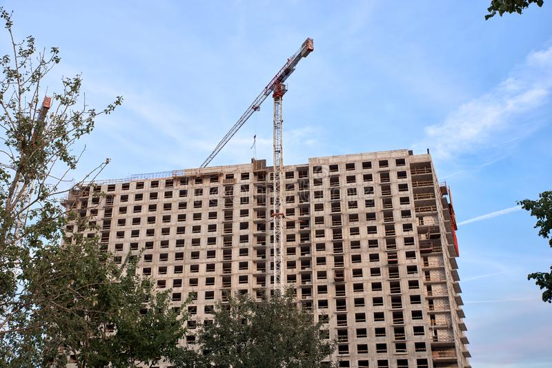 Construction of residential buildings of new neighborhoods.  the process of building a multi-storey residential building.  royalty free stock photo