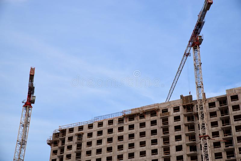 Construction of residential buildings of new neighborhoods. the process of building a multi-storey residential building.  royalty free stock photos
