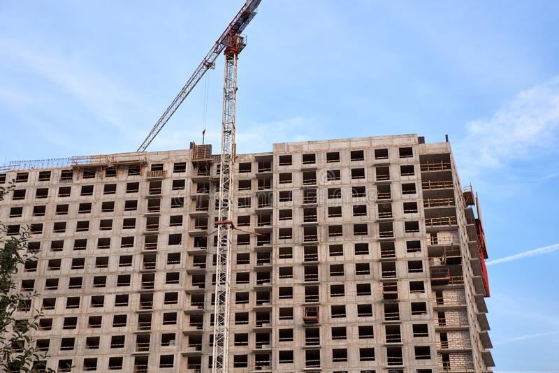 Construction of residential buildings of new neighborhoods. the process of building a multi-storey residential building.  royalty free stock image