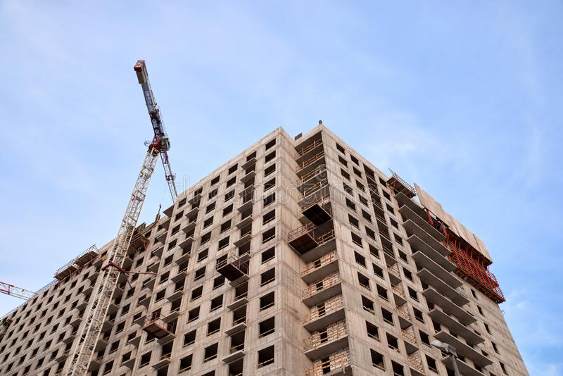 Construction of residential buildings of new neighborhoods. the process of building a multi-storey residential building.  royalty free stock photography
