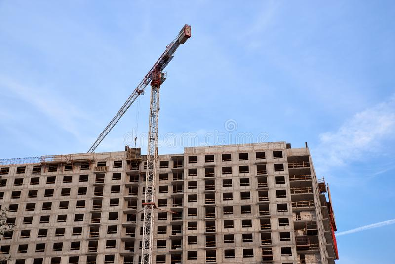 Construction of residential buildings of new neighborhoods. the process of building a multi-storey residential building.  stock photos