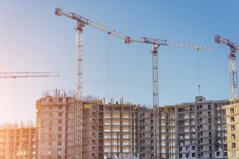 Construction of residential real estate of their solid concrete and bricks. View of high-rise houses and cranes.  stock images