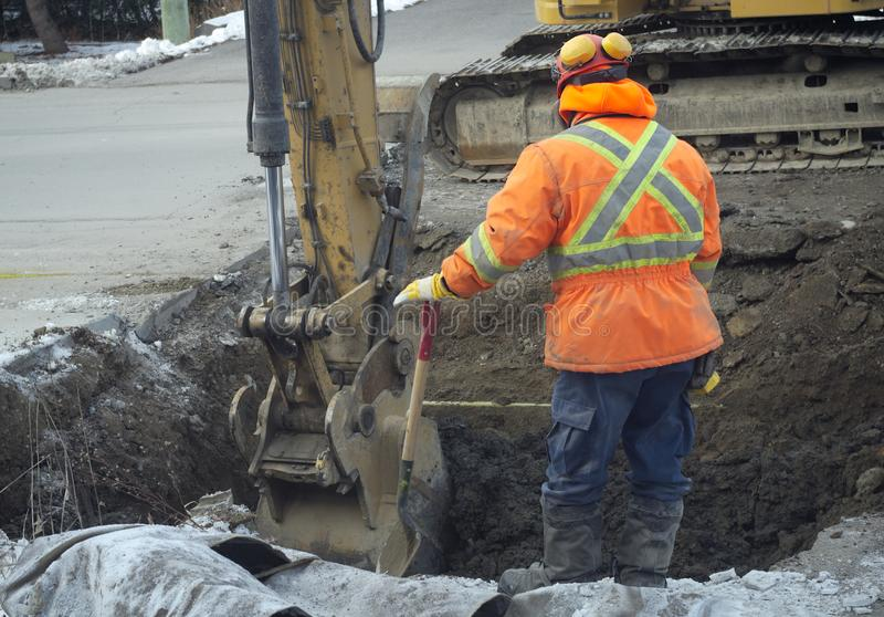 Construction worker shovel road repair drain sewer work excavation digger stock photo