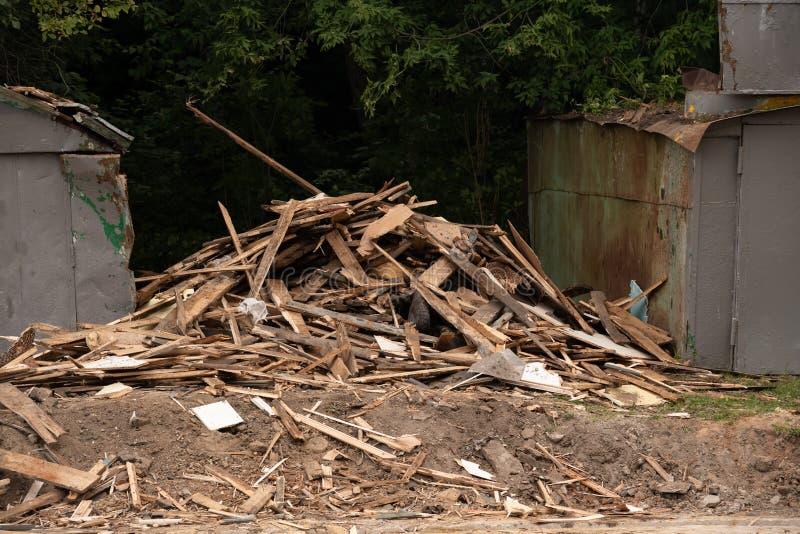 Construction rubble after the garage is demolished. Building, damage, danger, debris, demolition, destruction, disaster, insurance, structure, architecture stock photos