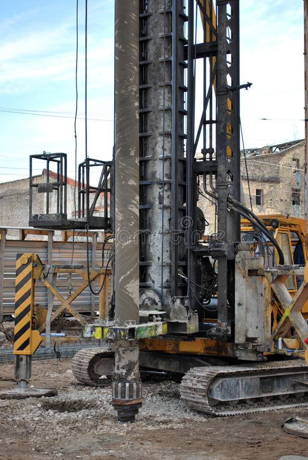 Construction site. With working drilling machine stock photography