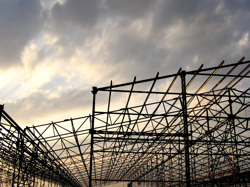 Construction site. Sunrays make a factory construction site look beautiful stock images