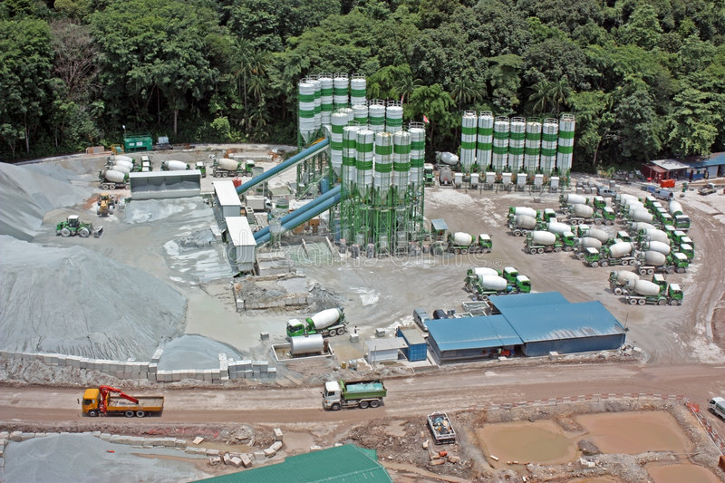 Construction site. Arial view of a cement silos and parked mixers at a construction site stock photography