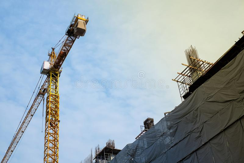 Construction site building with yellow cranes on sky with cloud royalty free stock images