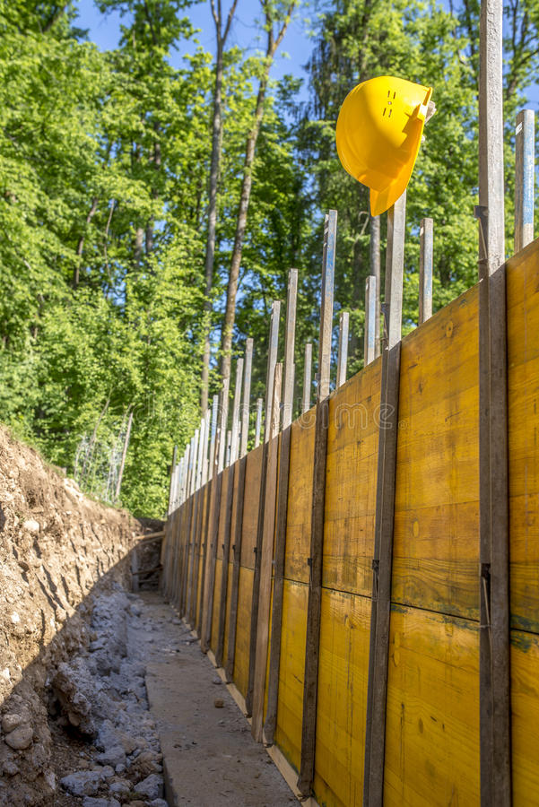 Construction Site Concept with a Bright Yellow Hard Hat royalty free stock photo