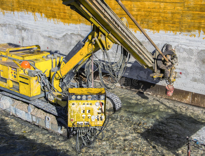 Construction Site, construction machinery. Consolidation of a wall, river embankment royalty free stock photo
